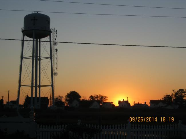 Water tower at sunrise